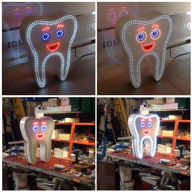Необычный зуб для вывески стоматология